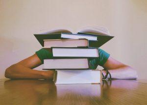 students hidden behind books